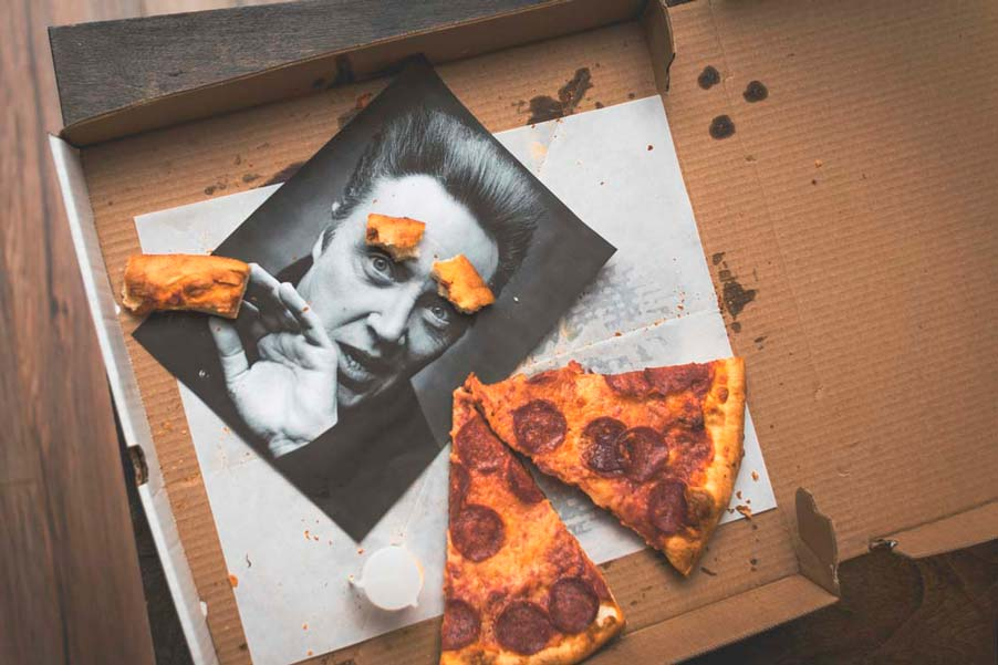 picture of a pizza box with a picture of Christopher Walken and two pieces of pepperoni pizza