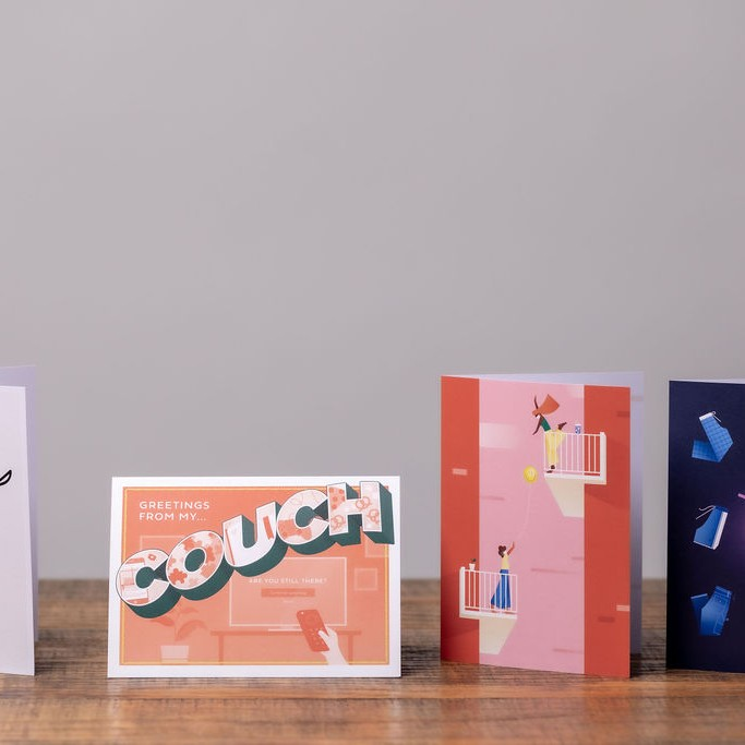 Four greeting cards on table